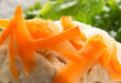 Closeup of carrot shavings on Gefilte Fish