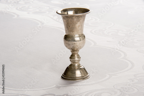 Kiddush Cup Resting on Linen tablecloth