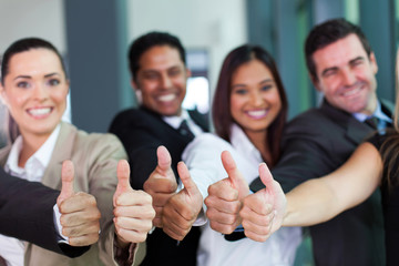 business group giving thumbs up