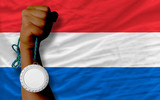 Silver medal for sport and  national flag of holland