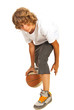 Teenager dribbling basketball