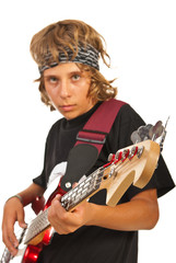 Teen boy playing bass guitar