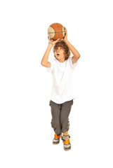 Teen boy playing basketball