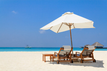 Scenery of the beach with a white parasol