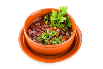 Bowl of mexican chili kidney bean soup with meat