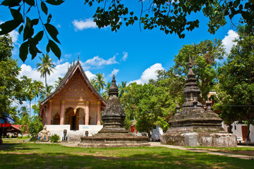 "A temple ""Wat Aham"" with blue sky in Luang Prabang"