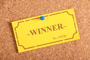 Winner Ticket on a cork notice board