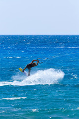 young kiter in the turquoise sea