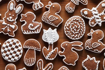 Easter gingerbread cookies on wooden background.