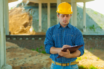 contractor writing in clipboard