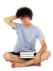 Pensive teenager with books.
