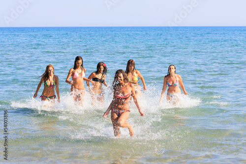 happy teenagers girls in the sea
