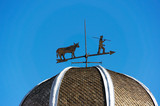 weather vane against blue sky