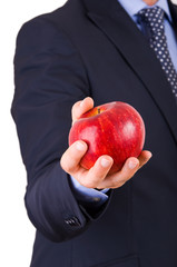 Businessman holding a red apple.