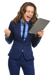 Happy business woman with tablet pc rejoicing success