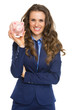 Smiling business woman showing piggy bank