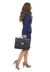 Full length portrait of business woman with briefcase going