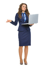 Full length portrait of clueless business woman with laptop