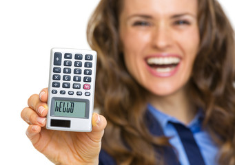 Closeup on calculator with hello inscription in hand of woman