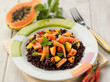 black rice with papaya and smoked salmon, selective focus