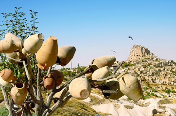 Pottery  tree in front of Uchisar Castle in Cappadocia, Turkey
