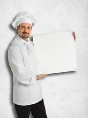 Italian chef showing the menu