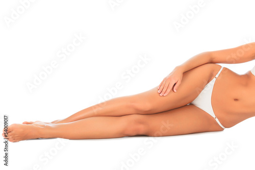 Woman laying on the white floor. Copyspace.