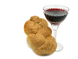 Challah  with glass of wine for Shabbat, isolated.