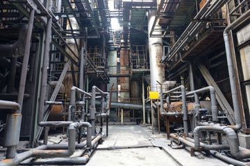 steel mill interior with pipes and valves