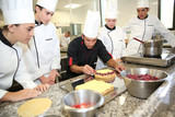 Students with teacher in pastry training course