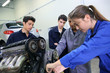 Mechanics training class with teacher and students - 54013862