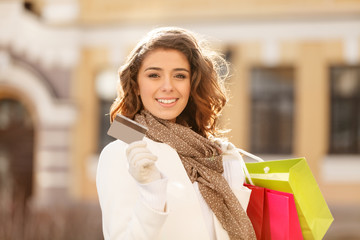 Shopping made easy! Beautiful young women holding a credit card
