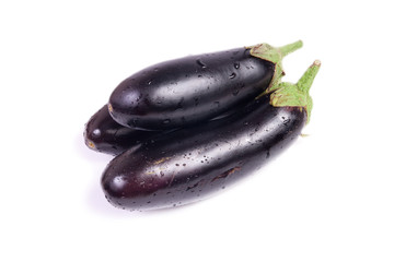 three fresh eggplants isolated on white