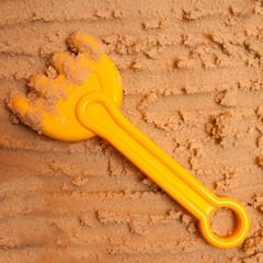 a beach rake on the sand