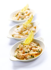 three bowls with prawns and garlic butter