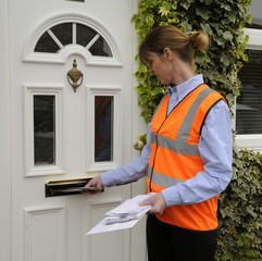Postwoman delivering mail