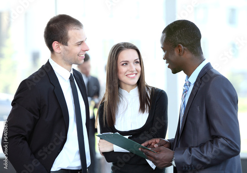 Image of business partners discussing documents and ideas