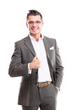 Happy smiling young business man with thumbs up gesture