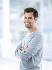 Smiling young businessman in casual