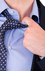 Businessman pulling his collar.