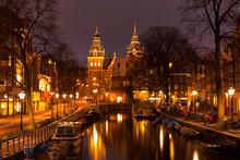 Amsterdam in de avond. Bekijk in het Rijksmuseum