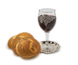 Challah  with glass of wine for Shabbat, isolated