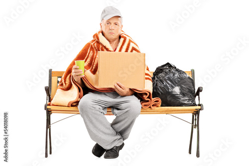 Homeless man sitting on a bench