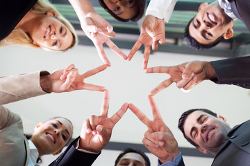 business people hands forming a star shape