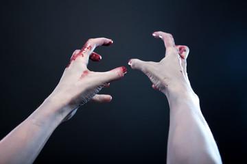 Grey skin bloody zombie hands