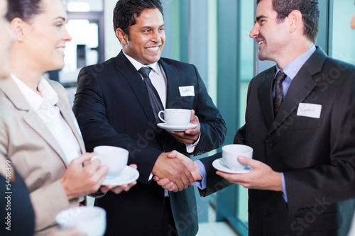 business people interacting during conference