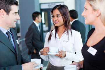 businesspeople interacting during conference coffee break