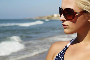 Beautiful blond woman on the beach