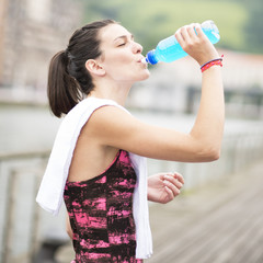 Woman Drinking Energy Drinc After Sport.