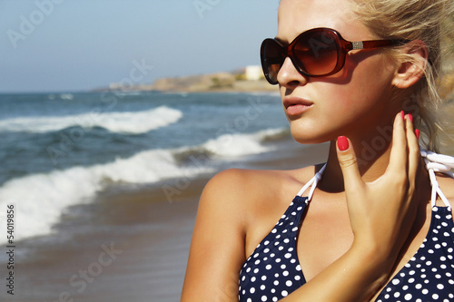 Beautiful blond woman on the beach